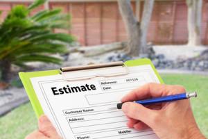 Hand Writing an Estimate for Garden Maintenance